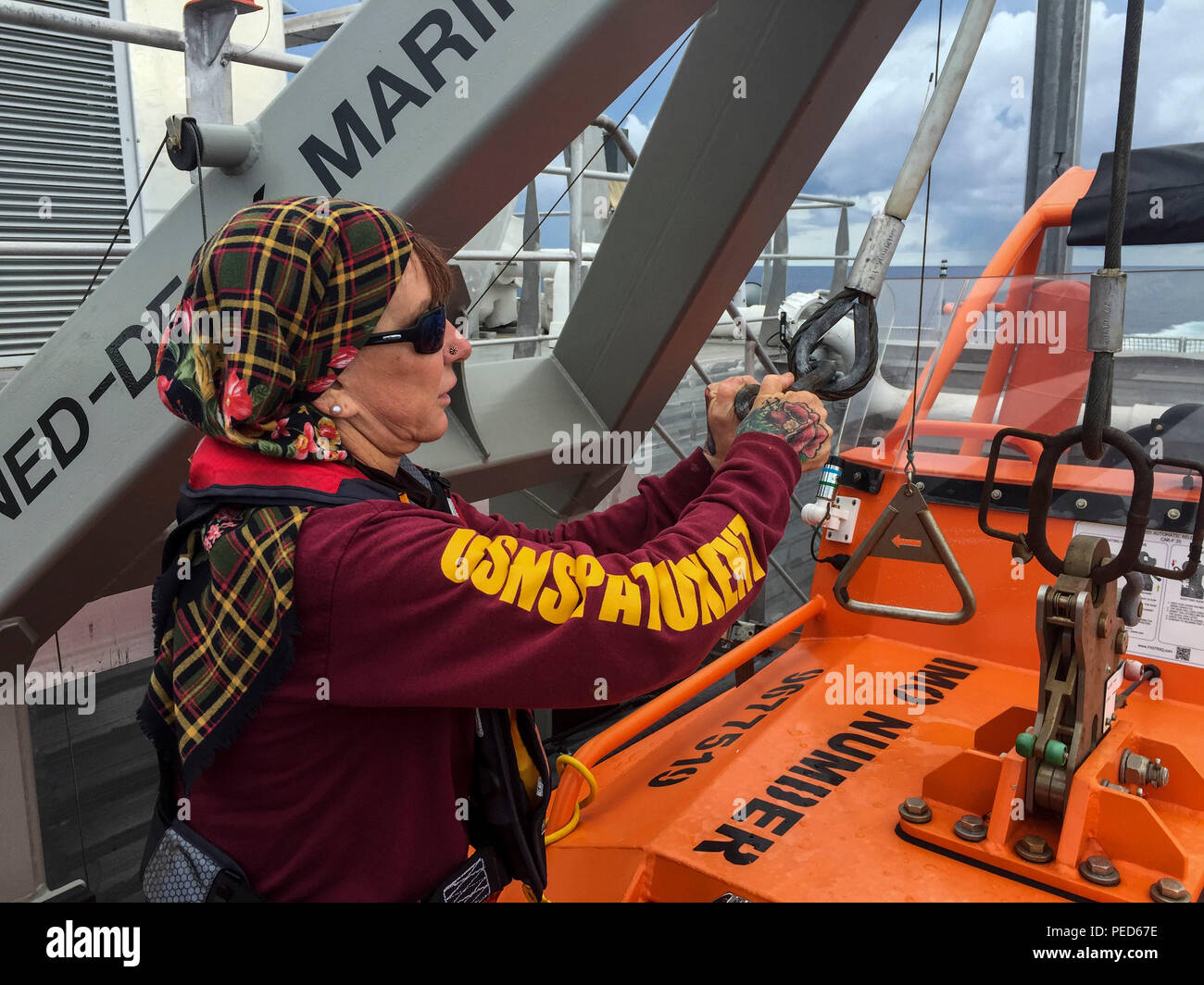 150803-M-GO800-044 PACIFIC OCEAN (Aug. 3, 2015) – Civilian Mariner Shannon Alves tightens the chains holding vehicles aboard the Military Sealift Command joint high speed vessel USNS Millinocket (JHSV 3) Aug. 3. Alves is responsible for the upkeep and maintenance of all the equipment aboard the Millinocket. Task Force Forager, embarked aboard the Millinocket is serving as the secondary platform for Pacific Partnership, led by an expeditionary command element from the Navy's 30th Naval Construction Regiment (30 NCR) from Port Hueneme, Calif. Now in its 10th iteration, Pacific Partnership is the - Stock Image