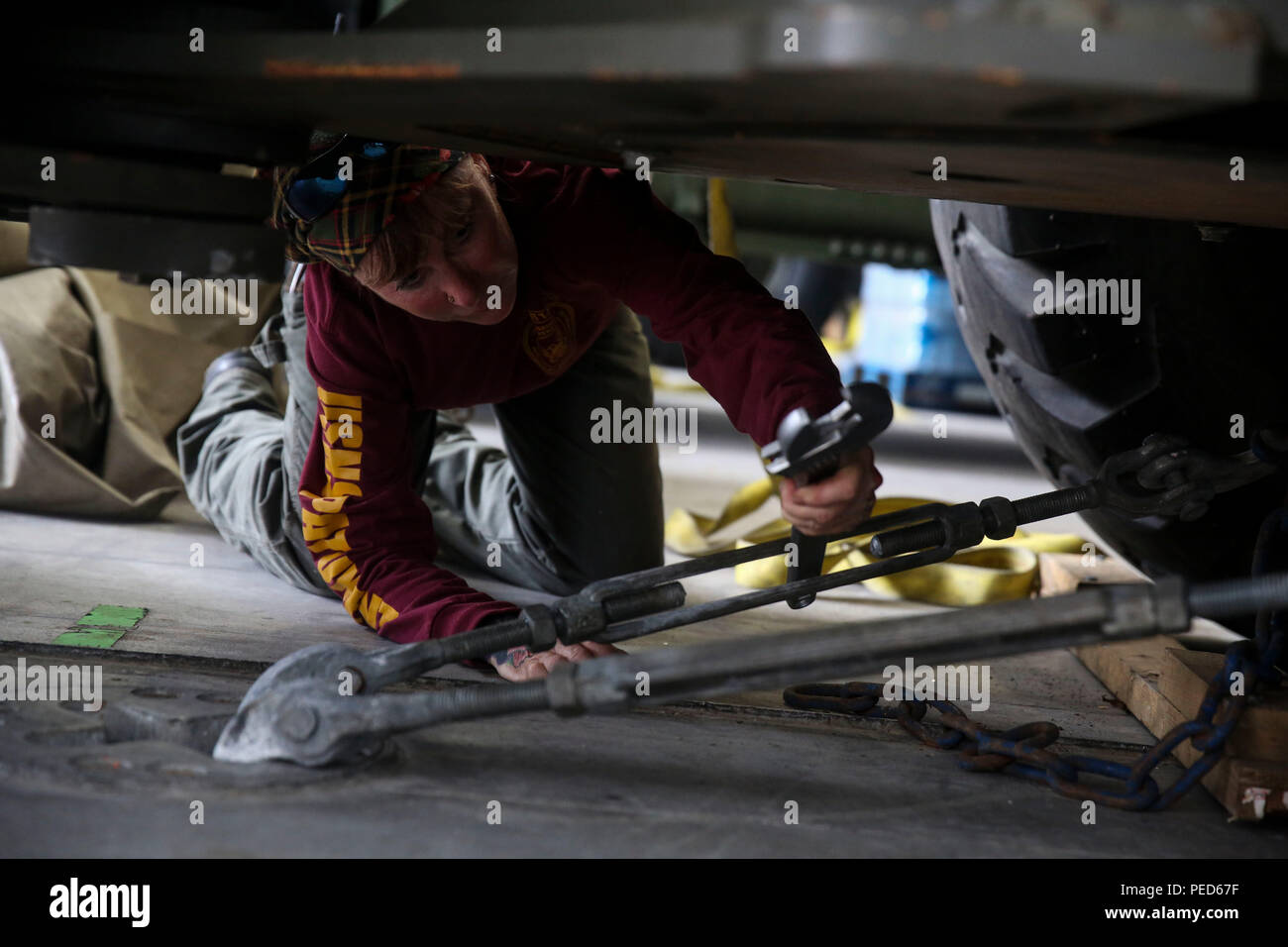 150803-M-GO800-013 PACIFIC OCEAN (Aug. 3, 2015) – Civilian Mariner Shannon Alves pumps excess water out of the life boats aboard the Military Sealift Command joint high speed vessel USNS Millinocket (JHSV 3) Aug. 3. Alves is responsible for the upkeep and maintenance of all the equipment aboard the Millinocket. Task Force Forager, embarked aboard the Millinocket is serving as the secondary platform for Pacific Partnership, led by an expeditionary command element from the Navy's 30th Naval Construction Regiment (30 NCR) from Port Hueneme, Calif. Now in its 10th iteration, Pacific Partnership is - Stock Image