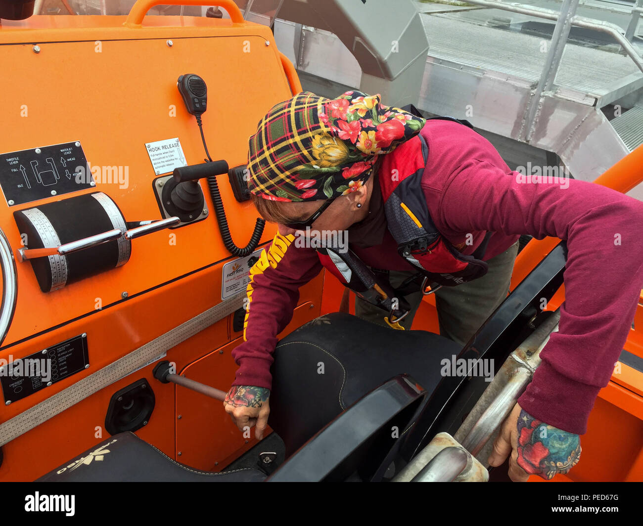150803-M-GO800-034 PACIFIC OCEAN (Aug. 3, 2015) – Civilian Mariner Shannon Alves inspects the chains holding up the lifeboat aboard the Military Sealift Command joint high speed vessel USNS Millinocket (JHSV 3) Aug. 3. Alves is responsible for the upkeep and maintenance of all the equipment aboard the Millinocket. Task Force Forager, embarked aboard the Millinocket is serving as the secondary platform for Pacific Partnership, led by an expeditionary command element from the Navy's 30th Naval Construction Regiment (30 NCR) from Port Hueneme, Calif. Now in its 10th iteration, Pacific Partnership - Stock Image