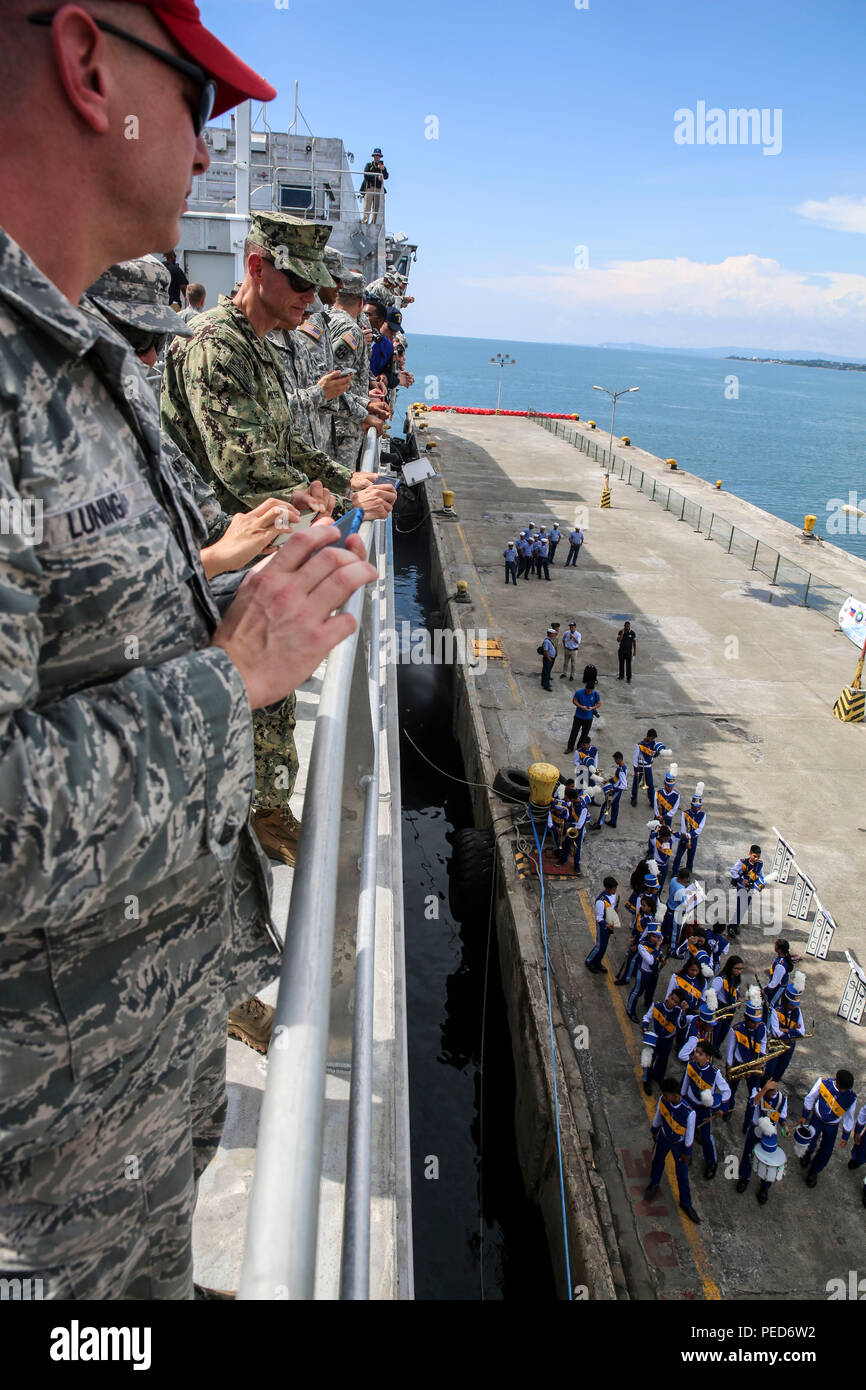 150804-M-GO800-109 SAN FERNANDO CITY, Philippines (Aug. 4, 2015) – Service members with Pacific Partnership 2015 aboard the Military Sealift Command joint high speed vessel USNS Millinocket (JHSV 3) observe as locals play instruments, welcoming them to the Philippines, Aug. 4. Task Force Forager will be in the Philippines until Aug. 15 providing a medical and engineering assistance. Task Force Forager, embarked aboard the Millinocket is serving as the secondary platform for Pacific Partnership, led by an expeditionary command element from the Navy's 30th Naval Construction Regiment (30 NCR) fr - Stock Image