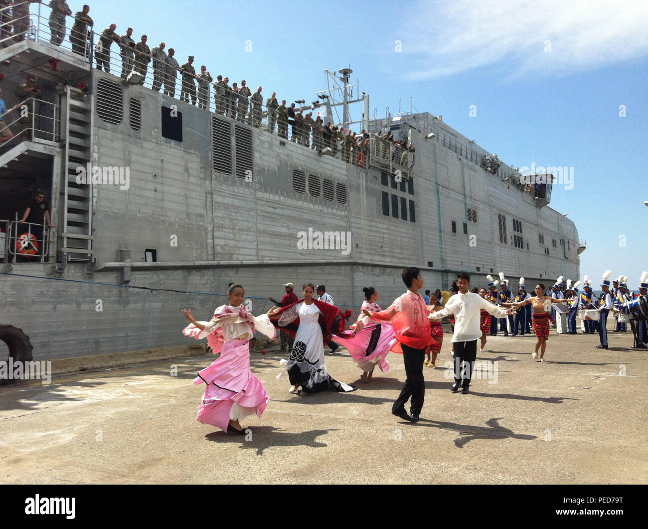 150804-N-ZZ999-021 SAN FERNANDO CITY, Philippines (Aug. 4, 2015) – Traditional Filipino dancers perform as the Military Sealift Command joint high speed vessel USNS Millinocket (JHSV 3) arrives in San Fernando City, Aug. 4. Millinocket is in the Philippines for the fourth stop of Pacific Partnership 2015. Millinocket and embarked Task Force Forager are serving as the secondary platform for Pacific Partnership, led by an expeditionary command element from the Navy's 30th Naval Construction Regiment (30 NCR) from Port Hueneme, Calif. Now in its 10th iteration, Pacific Partnership is the largest  - Stock Image