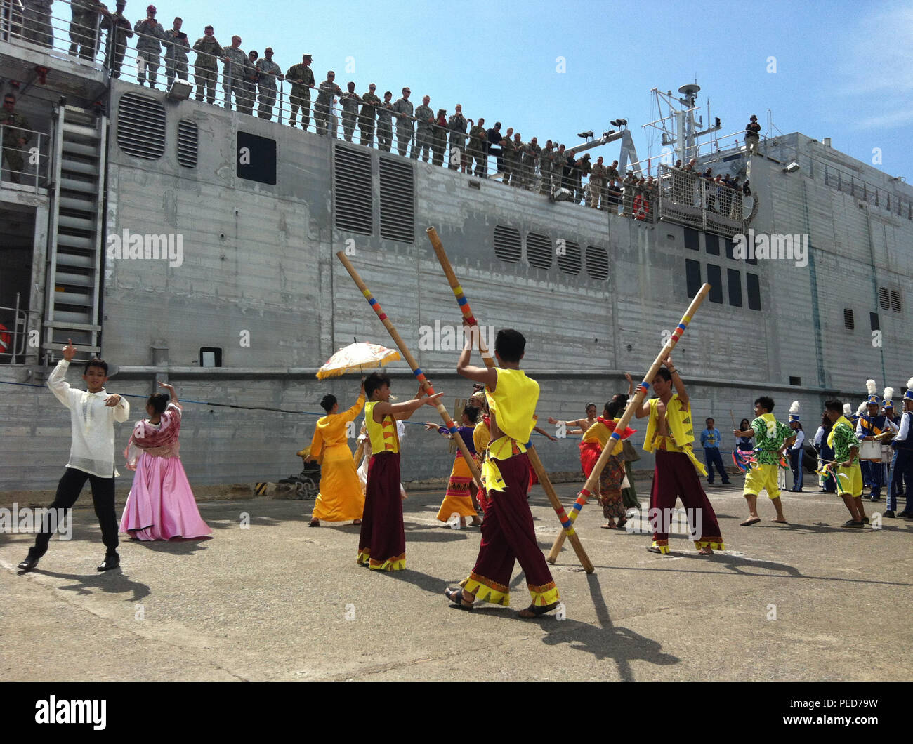 150804-N-ZZ999-026 SAN FERNANDO CITY, Philippines (Aug. 4, 2015) – Traditional Filipino dancers perform as the Military Sealift Command joint high speed vessel USNS Millinocket (JHSV 3) arrives in San Fernando City Aug. 4. Millinocket is in the Philippines for the fourth stop of Pacific Partnership 2015. Millinocket and embarked Task Force Forager are serving as the secondary platform for Pacific Partnership, led by an expeditionary command element from the Navy's 30th Naval Construction Regiment (30 NCR) from Port Hueneme, Calif. Now in its 10th iteration, Pacific Partnership is the largest a - Stock Image