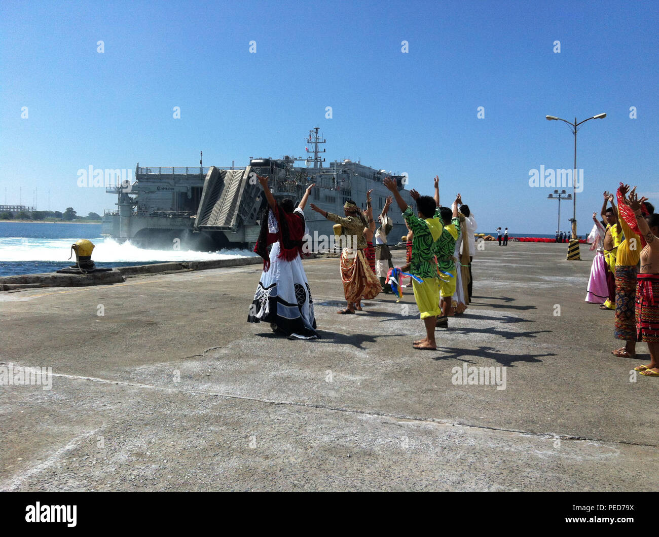 150804-N-ZZ999-008 SAN FERNANDO CITY, Philippines (Aug. 4, 2015) – Traditional Filipino dancers perform as the Military Sealift Command joint high speed vessel USNS Millinocket (JHSV 3) arrives in San Fernando City, Aug. 4. Millinocket is in the Philippines for the fourth stop of Pacific Partnership 2015. Millinocket and embarked Task Force Forager are serving as the secondary platform for Pacific Partnership, led by an expeditionary command element from the Navy's 30th Naval Construction Regiment (30 NCR) from Port Hueneme, Calif. Now in its 10th iteration, Pacific Partnership is the largest  - Stock Image