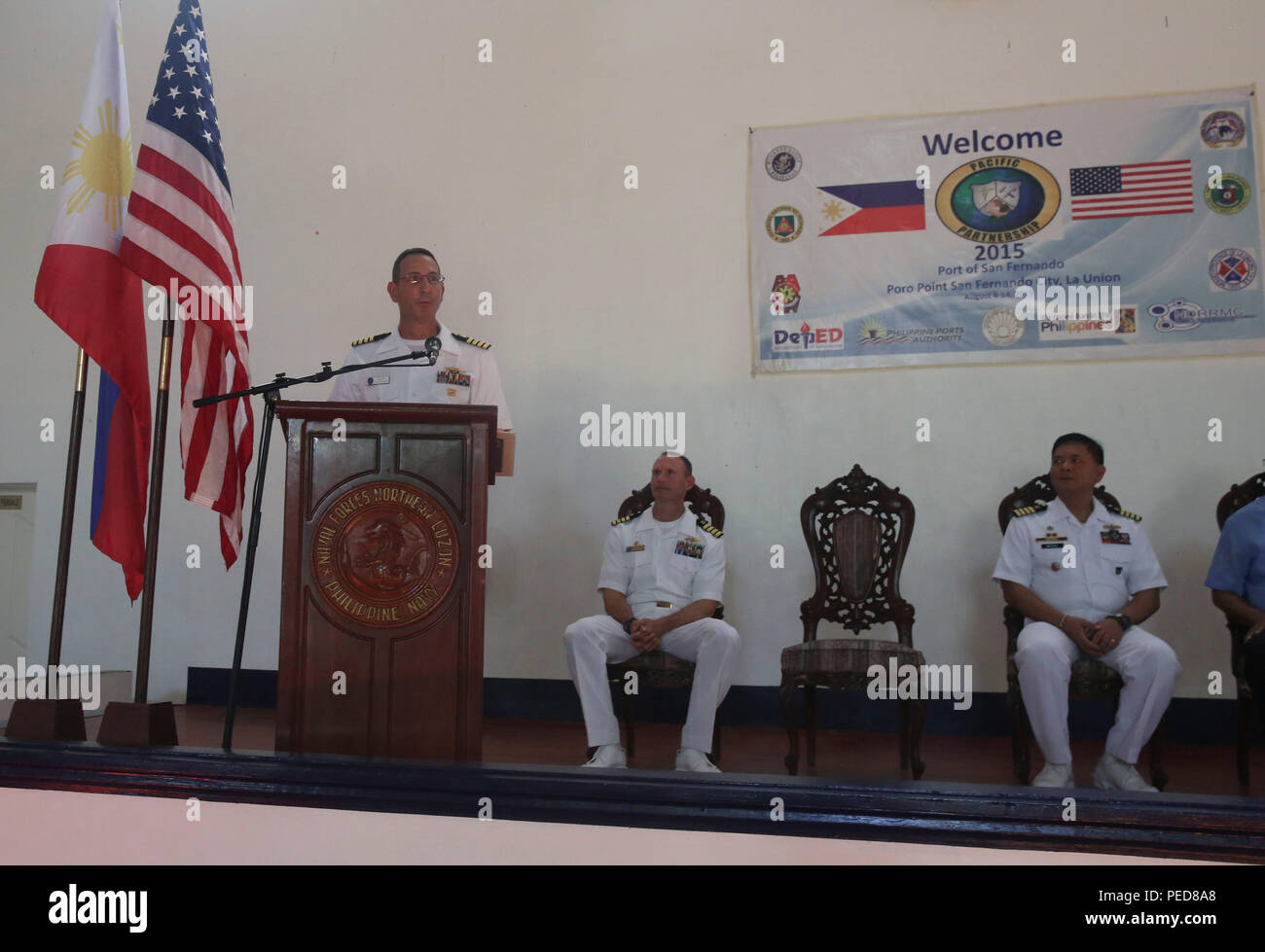 150806-M-GO800-062 SAN FERNANDO CITY, Philippines (August 6, 2015) – Fleet Surgeon at Commander, Seventh Fleet, Capt. Joel Roos, delivers a speech on the importance of working with the Philippines during an opening ceremony Aug. 6. Task Force Forager will be in the Philippines until Aug.15 providing medical and engineering assistance. Task Force Forager, embarked aboard the Military Sealift Command joint high speed vessel USNS Millinocket (JHSV 3) is serving as the secondary platform for Pacific Partnership, led by an expeditionary command element from the Navy's 30th Naval Construction Regime - Stock Image
