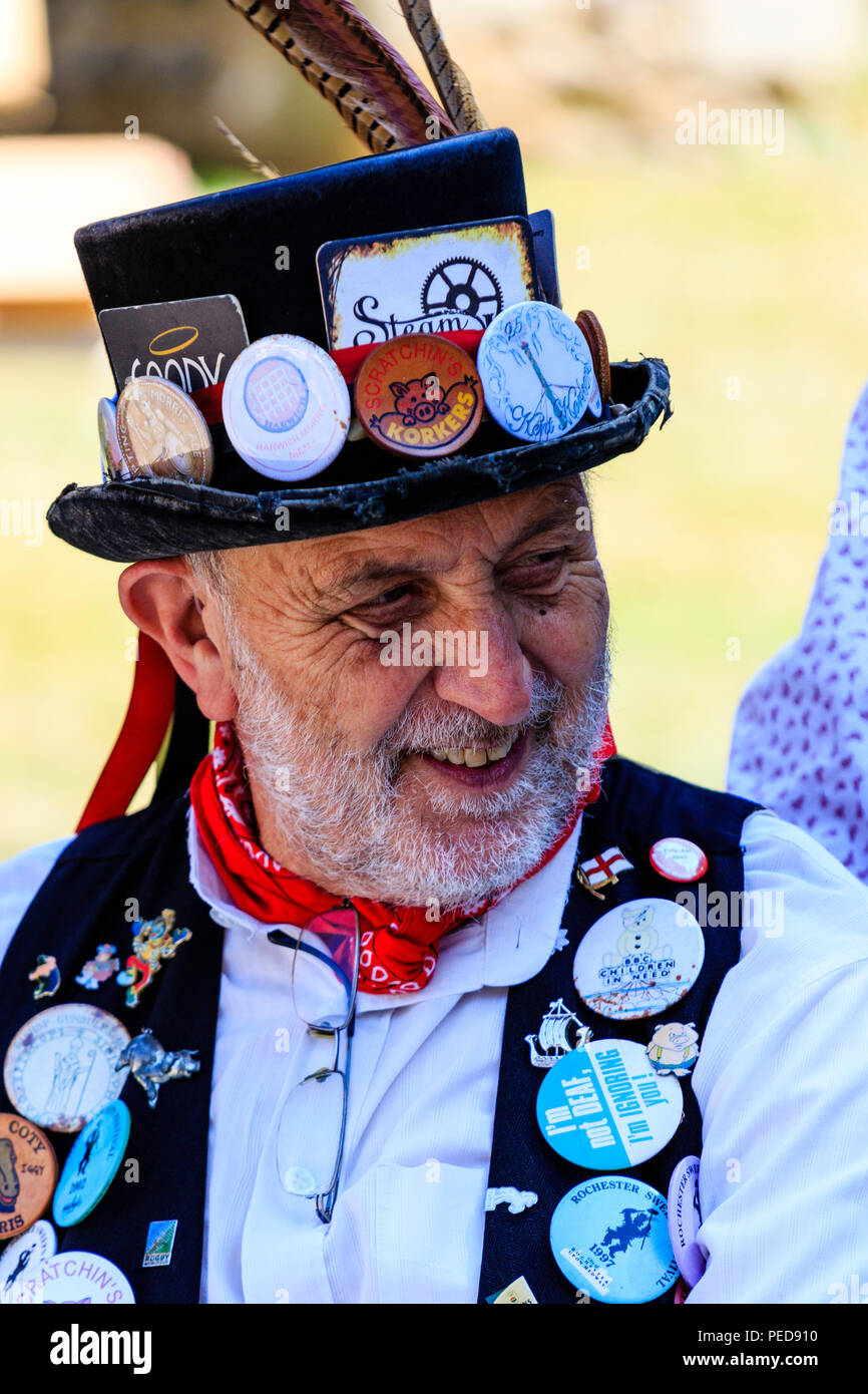 Traditional English folk dancer from the Kent Korkers & Pork Scratchin's morris. Mature male, light beard, wears black hat and waistcoat with badges o - Stock Image