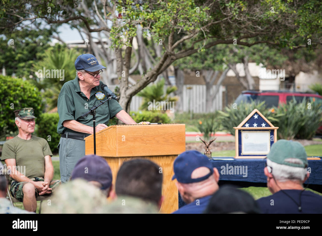 150807-N-NK714-010  150807-N-NK714-010 SAN DIEGO (Aug. 7, 2015) – Vietnam veterans and sailors attached to Coastal Riverine Group 1 (CGR 1) listen to Cmdr. (Ret.) Bob Bolger, Officer in Charge of Patrol Fast Craft 99 (PCF-99) in I Corps, as he speaks about his experiences as an officer in Vietnam. Bolger's unit was in the northern tactical zone of South Vietnam from 1966 -1967 and Bolger is now active in several veteran groups in the greater San Diego area. (U.S. Navy Photo by MC2 Nolan Kahn/Released) - Stock Image