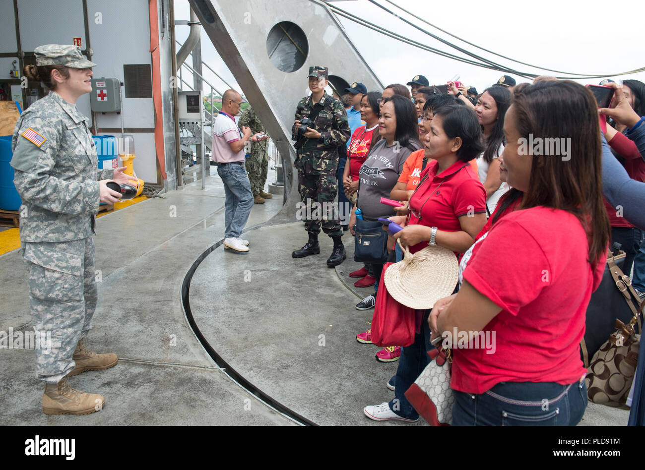 150808-N-MK341-005 SAN FERNANDO CITY, Philippines (August 8, 2015) – Army Capt. Desiree Giangregorio talks to guests during a ship tour of the Military Sealift Command joint high speed vessel USNS Millinocket (JHSV 3) Aug. 8. Millinocket is in the Philippines for the fourth stop of Pacific Partnership 2015. Millinocket and embarked Task Force Forager are serving as the secondary platform for Pacific Partnership, led by an expeditionary command element from the Navy's 30th Naval Construction Regiment (30 NCR) from Port Hueneme, California. Now in its 10th iteration, Pacific Partnership is the l - Stock Image