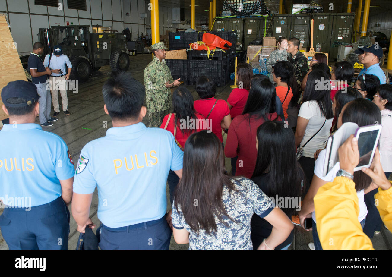 150808-N-MK341-023 SAN FERNANDO CITY, Philippines (August 8, 2015) – Lt. Orlando White talks to guests during a ship tour of the Military Sealift Command joint high speed vessel USNS Millinocket (JHSV 3) Aug. 8. Millinocket is in the Philippines for the fourth stop of Pacific Partnership 2015. Millinocket and embarked Task Force Forager are serving as the secondary platform for Pacific Partnership, led by an expeditionary command element from the Navy's 30th Naval Construction Regiment (30 NCR) from Port Hueneme, California. Now in its 10th iteration, Pacific Partnership is the largest annual  - Stock Image