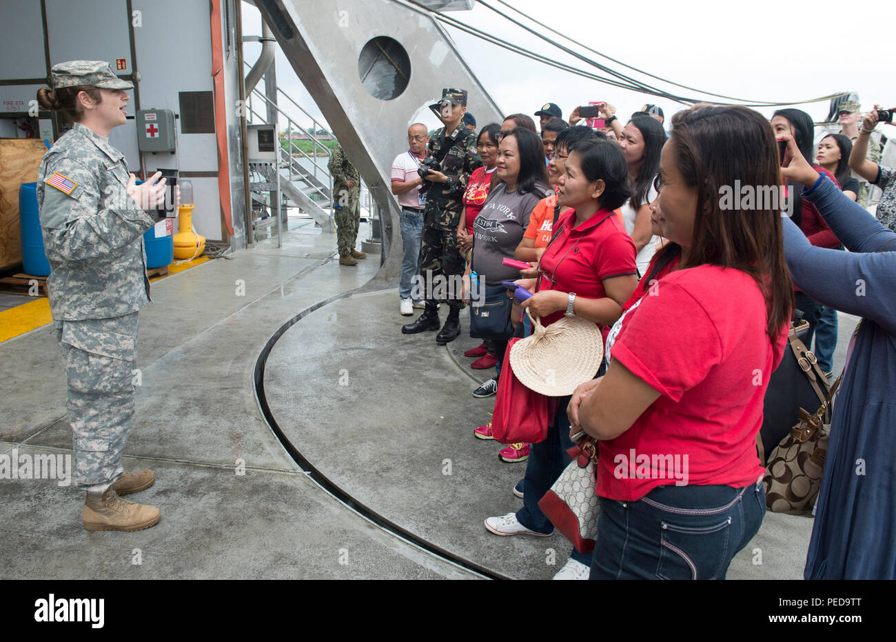 150808-N-MK341-011 SAN FERNANDO CITY, Philippines (August 8, 2015) – Army Capt. Desiree Giangregorio talks to guests during a ship tour of the Military Sealift Command joint high speed vessel USNS Millinocket (JHSV 3) Aug. 8. Millinocket is in the Philippines for the fourth stop of Pacific Partnership 2015. Millinocket and embarked Task Force Forager are serving as the secondary platform for Pacific Partnership, led by an expeditionary command element from the Navy's 30th Naval Construction Regiment (30 NCR) from Port Hueneme, California. Now in its 10th iteration, Pacific Partnership is the l - Stock Image