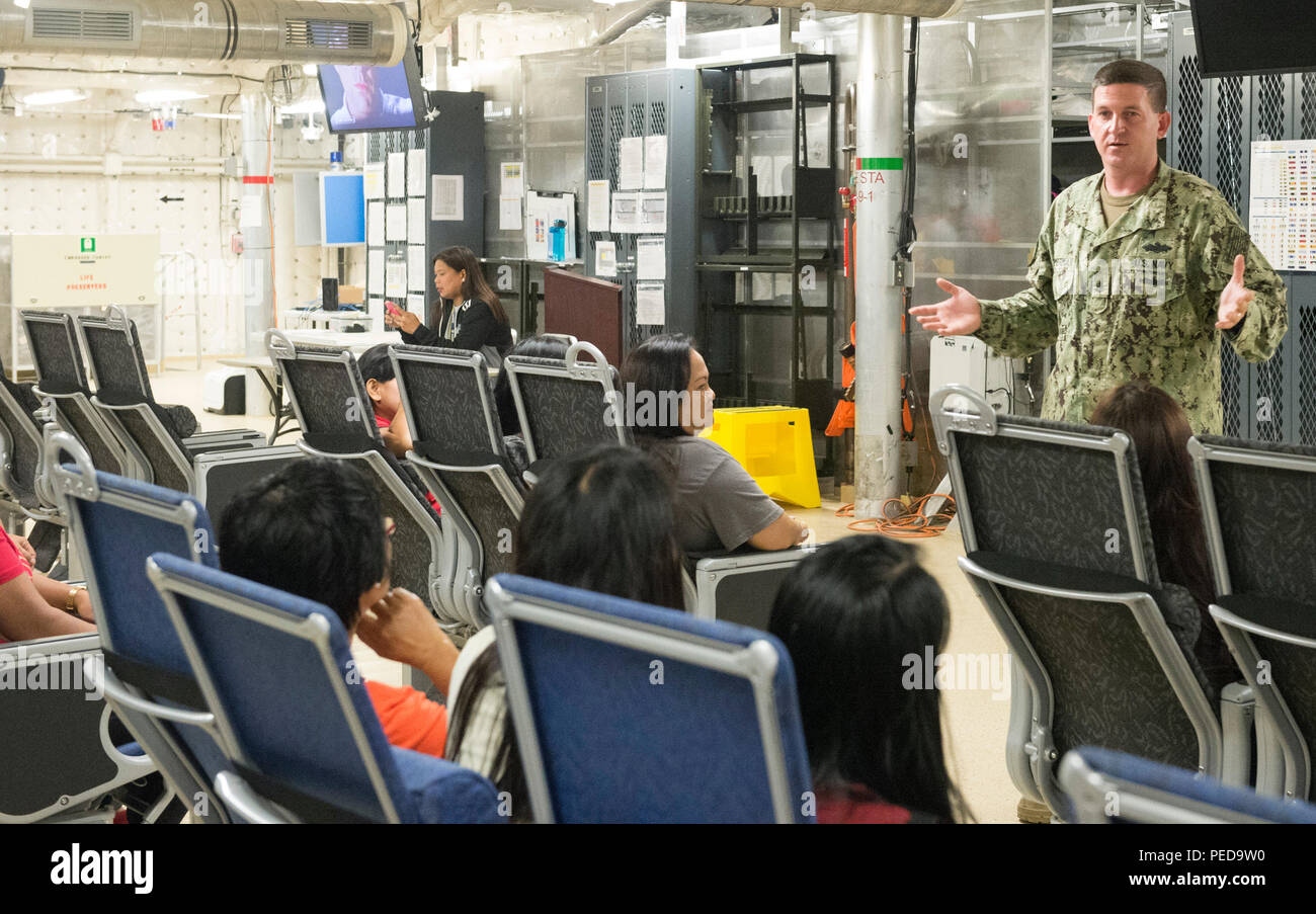 150808-N-MK341-056 SAN FERNANDO CITY, Philippines (August 8, 2015) – Chief Electronics Technician Eric Zimmerman talks to guests during a ship tour of the Military Sealift Command joint high speed vessel USNS Millinocket (JHSV 3) Aug. 8. Millinocket is in the Philippines for the fourth stop of Pacific Partnership 2015. Millinocket and embarked Task Force Forager are serving as the secondary platform for Pacific Partnership, led by an expeditionary command element from the Navy's 30th Naval Construction Regiment (30 NCR) from Port Hueneme, California. Now in its 10th iteration, Pacific Partners - Stock Image