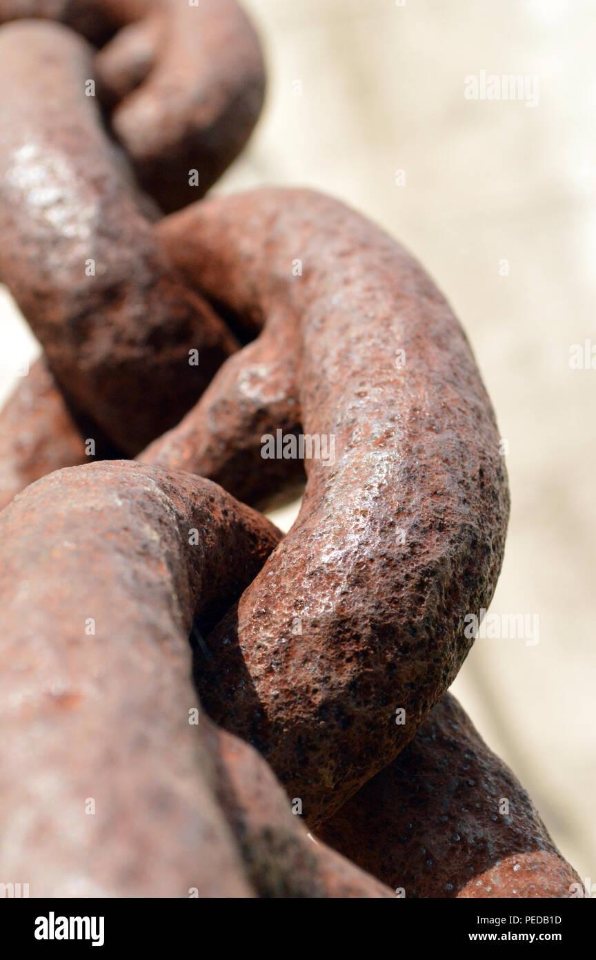 Rusty chain links on a drawbridge - Stock Image