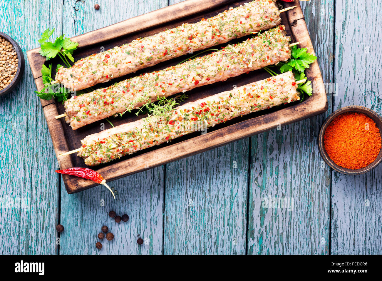 Raw turkish traditional dish meat kebab with herbs and spices ...