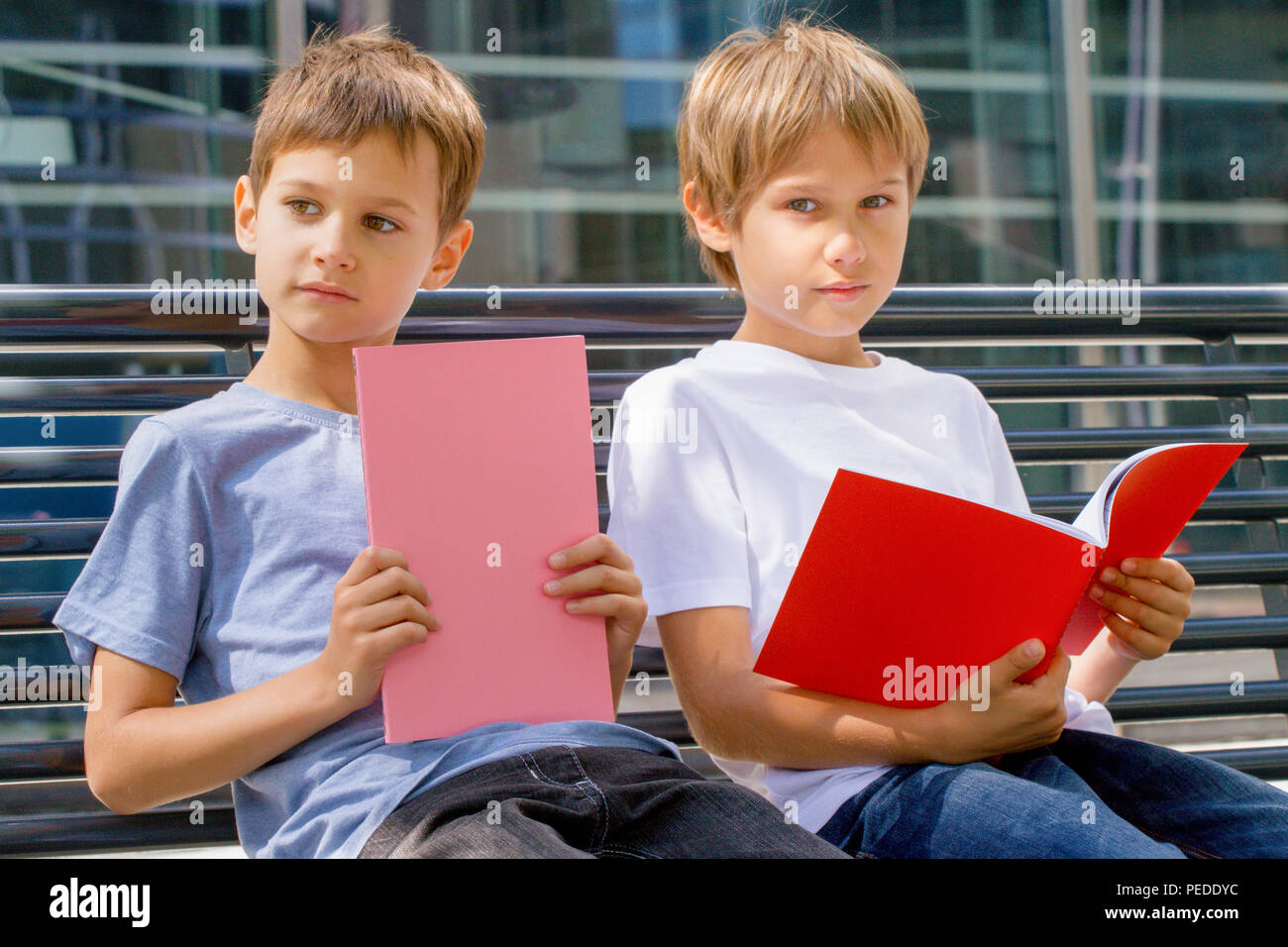 Boys doing homework outdoors. Back to school concept. - Stock Image