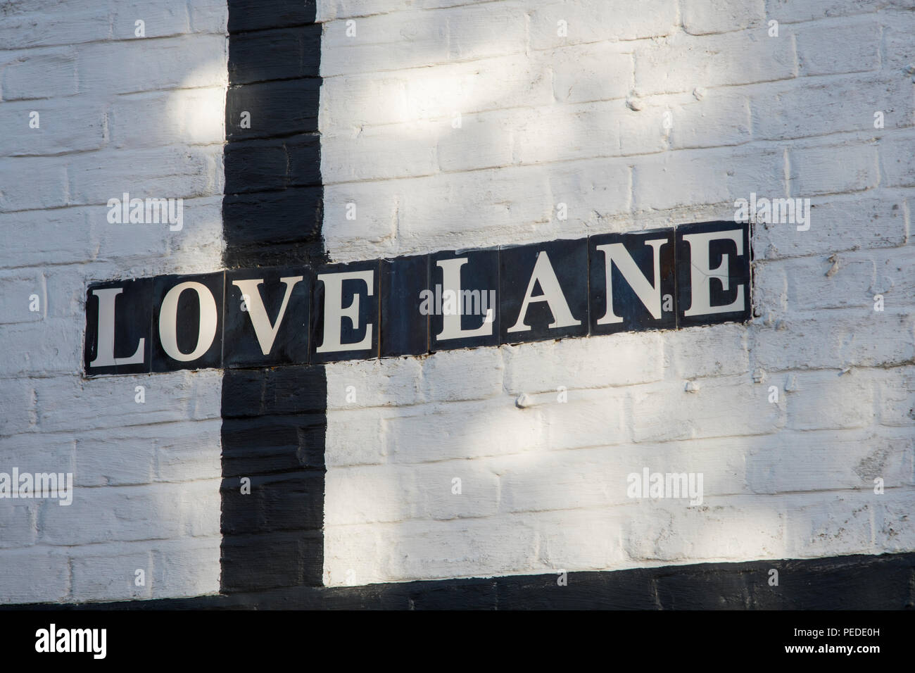 Love Land roadsign in the Cheshire village of Nantwich, Cheshire. - Stock Image