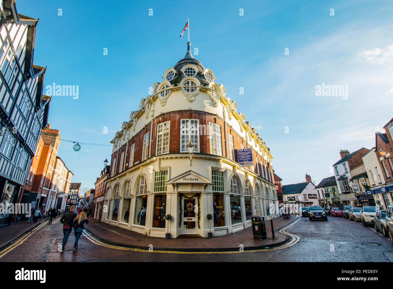 Pockets corner store in Nantwich on a cold clear December day - Stock Image
