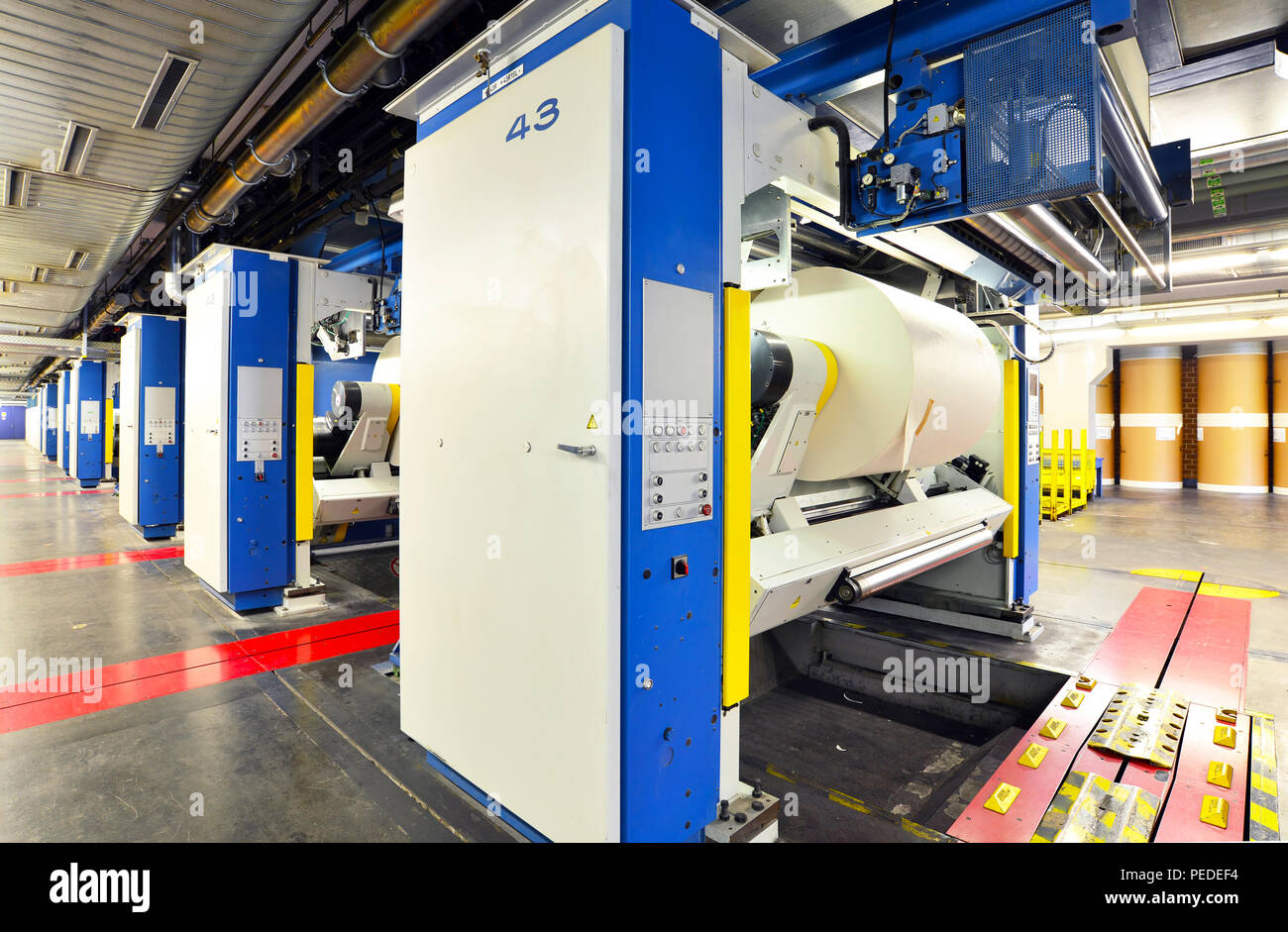 modern offset printing machines in a large print shop for production of newspapers & magazines - Stock Image