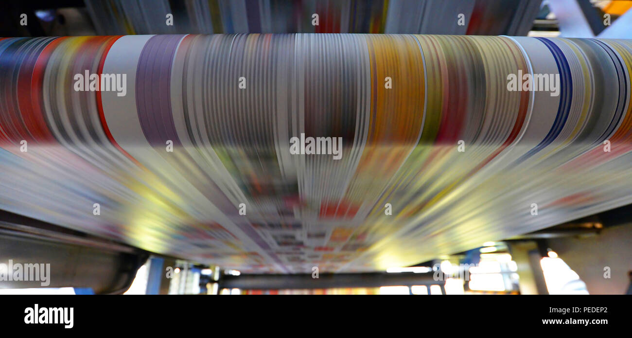 printing of coloured newspapers with an offset printing machine at a printing press - Stock Image