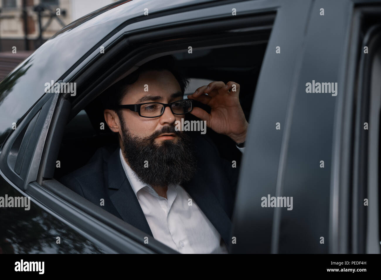 Close up portrair attractive young businessman in a car - Stock Image