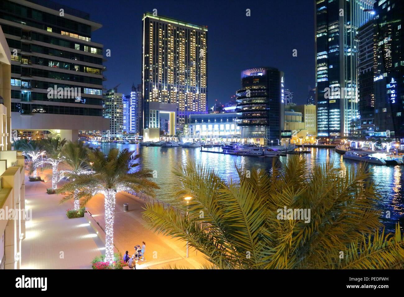 DUBAI, UAE - NOVEMBER 23, 2017: Night view of Dubai Marina, UAE. Dubai has 14.9 million annual tourists. - Stock Image