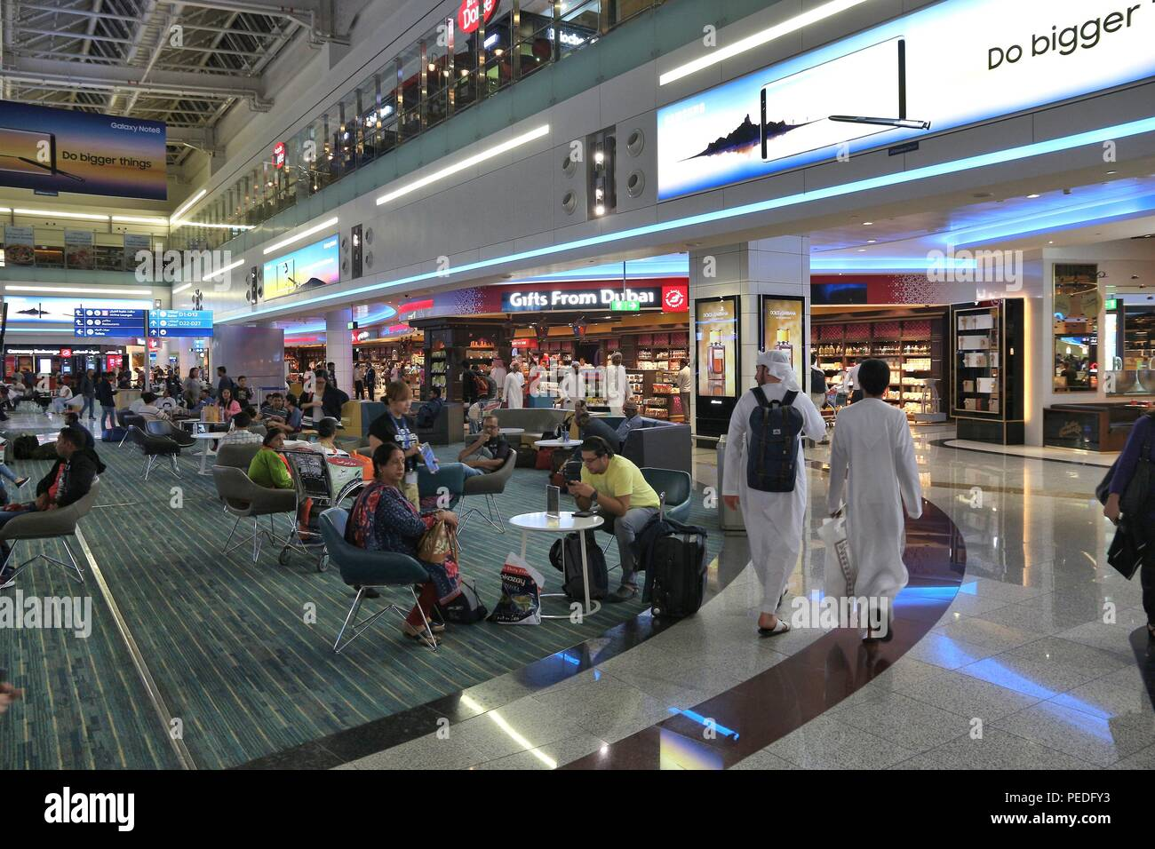 DUBAI, UAE - NOVEMBER 23, 2017: Passengers wait at Dubai International Airport, United Arab Emirates. It is the 3rd busiest airport in the world with  Stock Photo