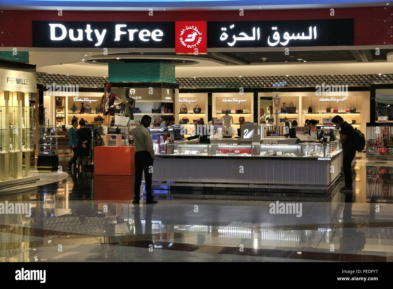 DUBAI, UAE - NOVEMBER 23, 2017: Passengers shop at duty free store at Dubai International Airport, United Arab Emirates. It is the 3rd busiest airport Stock Photo