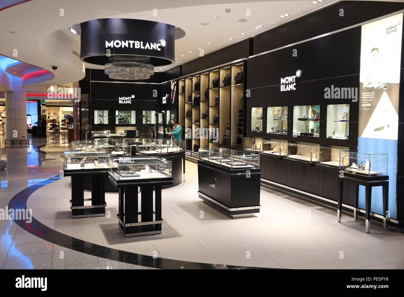 DUBAI, UAE - NOVEMBER 23, 2017: People shop at Montblanc store at Dubai International Airport, United Arab Emirates. The German brand Montblanc is fam Stock Photo