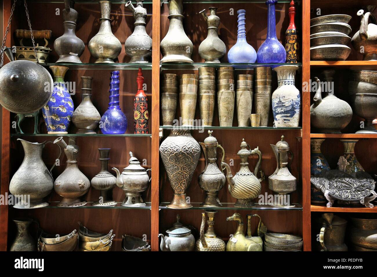 DUBAI, UAE - NOVEMBER 23, 2017: Antique brass jugs and glass vases at Souk Madinat Jumeirah in Dubai. The traditional Arab style bazaar is part of Mad Stock Photo