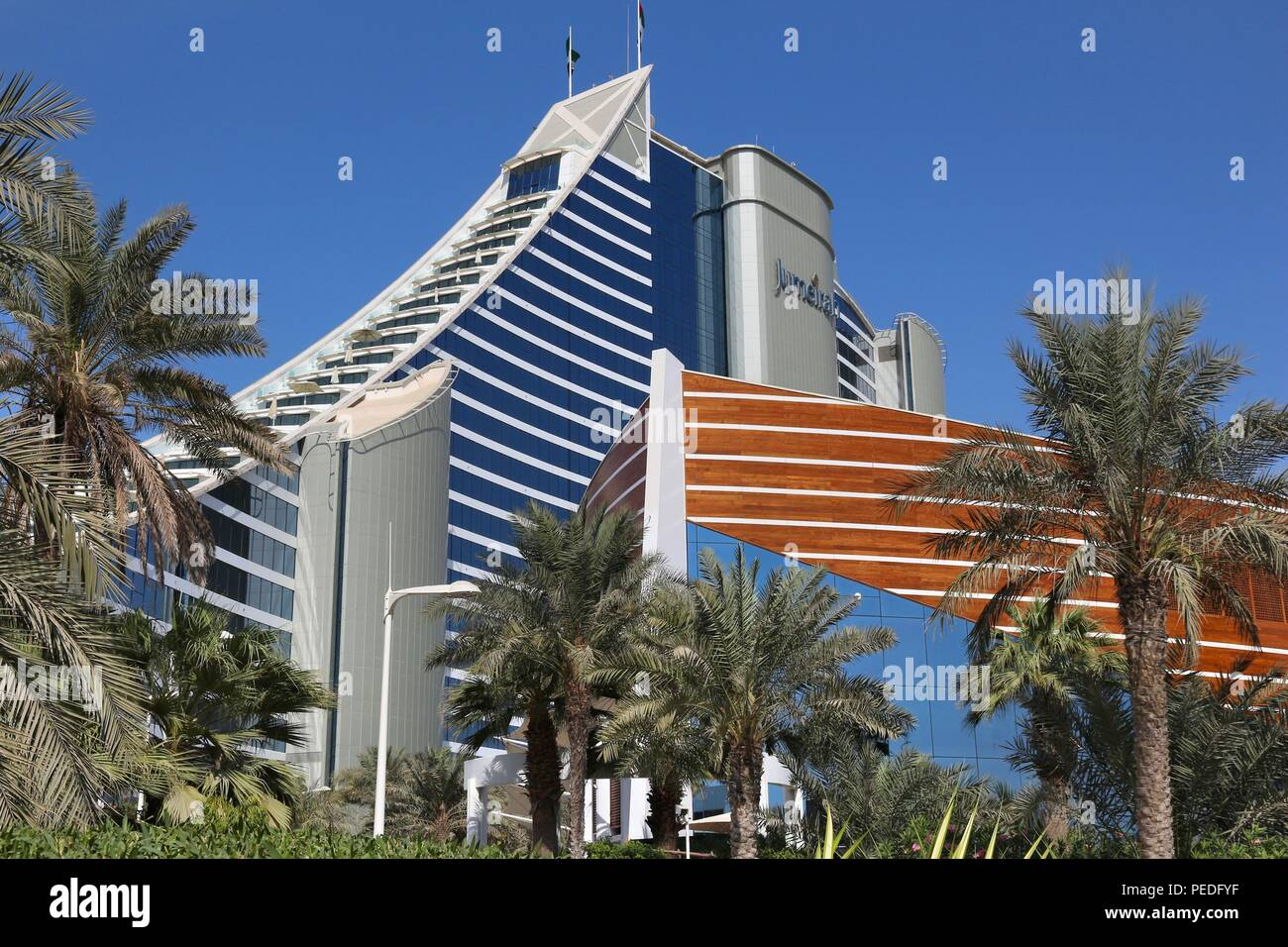 DUBAI, UAE - NOVEMBER 23, 2017: Jumeirah Beach Hotel in Dubai. The hotel was designed by British company WS Atkins. It is operated by Jumeirah Group. Stock Photo