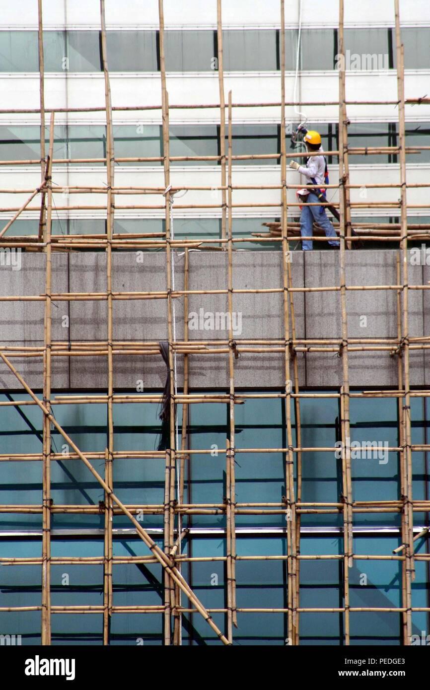 Bamboo scaffolding on commercial building, Hong Kong Island, Hong Kong - Stock Image
