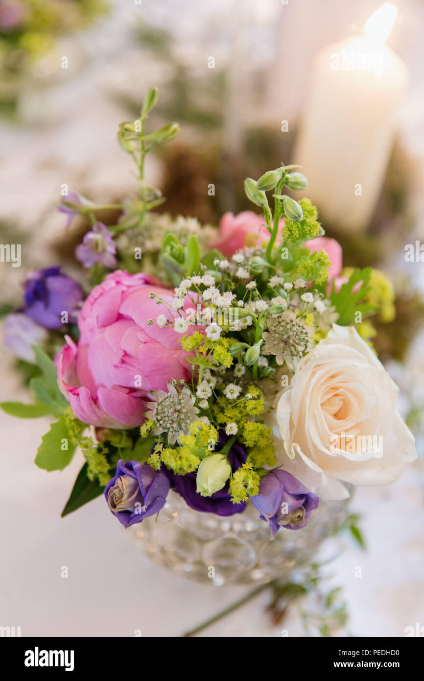 Pretty posies of English country garden flowers in vases. Table ...
