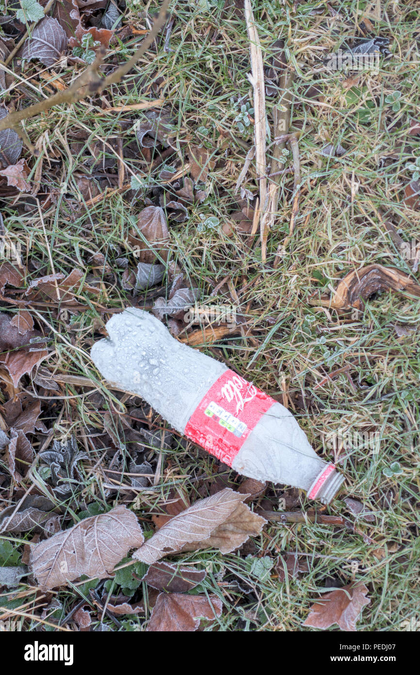 A discarded plastic drinks bottle littering the countryside Stock Photo