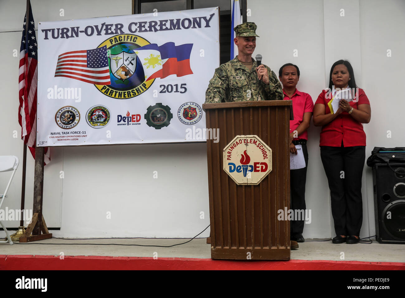 150810-M-GO800-241 SAN FERNANDO CITY, Philippines (Aug. 10, 2015) – Commodore, Task Force Forager Capt. James Meyer delivers a speech during a ribbon cutting ceremony at Eulogio Clarence M. De Guzman Elementary School Aug. 10. Task Force Forager will be in the Philippines until Aug. 15 providing medical and engineering assistance. Task Force Forager, embarked aboard the Military Sealift Command joint high speed vessel USNS Millinocket (JHSV 3) is serving as the secondary platform for Pacific Partnership, led by an expeditionary command element from the Navy's 30th Naval Construction Regiment ( - Stock Image