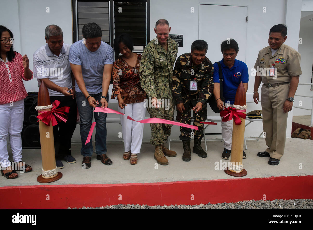 150810-M-GO800-344 SAN FERNANDO CITY, Philippines (Aug. 10, 2015) – Pacific Partnership 2015 and Philippine leadership cut the ribbon to Eulogio Clarence M. De Guzman Elementary School during a ribbon cutting ceremony Aug. 10. Task Force Forager will be in the Philippines until Aug. 15 providing medical and engineering assistance. Task Force Forager, embarked aboard the Military Sealift Command joint high speed vessel USNS Millinocket (JHSV 3) is serving as the secondary platform for Pacific Partnership, led by an expeditionary command element from the Navy's 30th Naval Construction Regiment ( - Stock Image