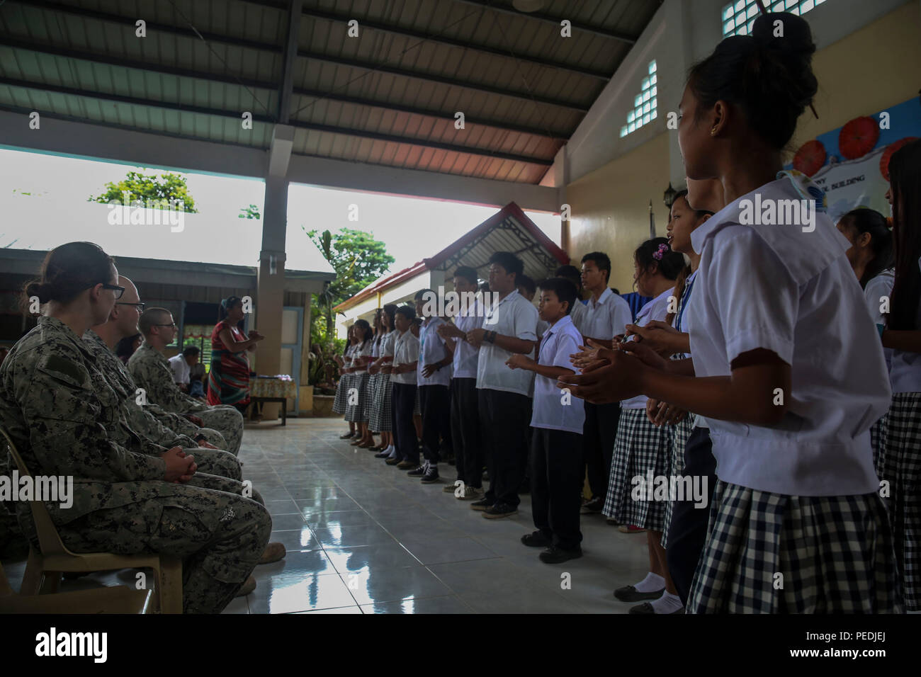 150810-M-GO800-592 SAN FERNANDO CITY, Philippines (Aug. 10, 2015) – Students at Caba National High School sing in appreciation for the work done by the Pacific Partnership 2015 team during a ribbon cutting ceremony Aug. 10. Task Force Forager will be in the Philippines until Aug. 15 providing medical and engineering assistance. Task Force Forager, embarked aboard the Military Sealift Command joint high speed vessel USNS Millinocket (JHSV 3) is serving as the secondary platform for Pacific Partnership, led by an expeditionary command element from the Navy's 30th Naval Construction Regiment (30  - Stock Image