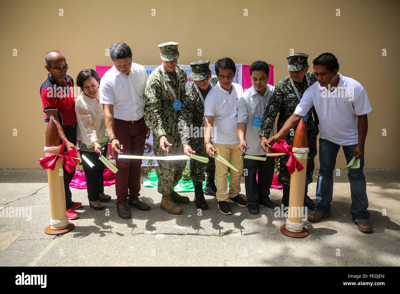150811-M-GO800-212 FERNANDO CITY, Philippines (Aug. 11, 2015) – Pacific Partnership 2015 leadership and Philippine leadership cut the ribbon at Boy-Utan Elementary School official opening it up for use Aug. 11. Task Force Forager will be in the Philippines until Aug. 15 providing medical and engineering assistance. Task Force Forager, embarked aboard the Military Sealift Command joint high speed vessel USNS Millinocket (JHSV 3) is serving as the secondary platform for Pacific Partnership, led by an expeditionary command element from the Navy's 30th Naval Construction Regiment (30 NCR) from Por - Stock Image