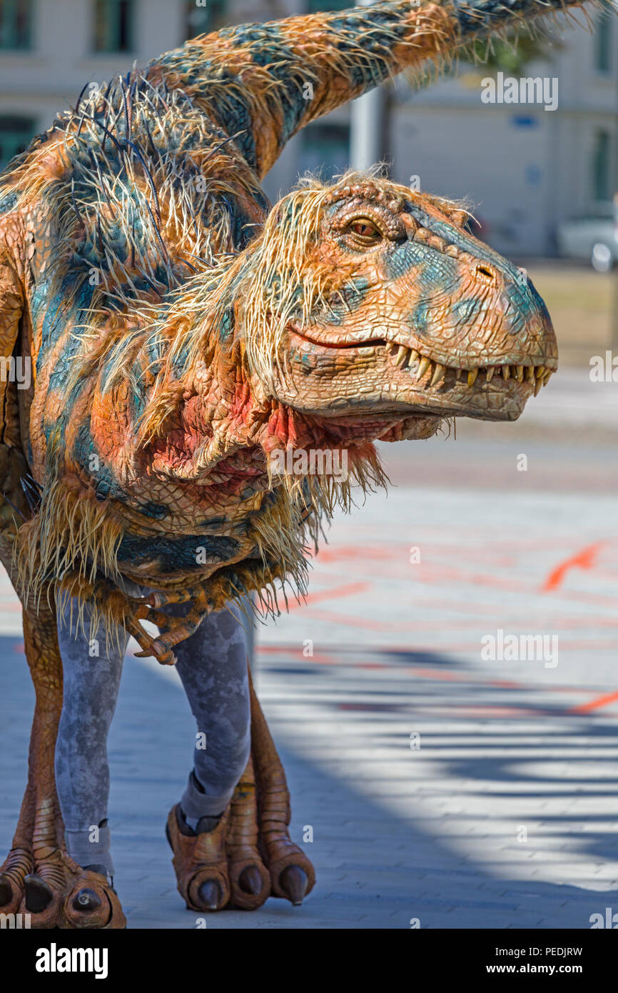 Life size creature from Walking with Dinosaurs - the $20 million arena spectacular walking around the streets of Gothenburg - Stock Image