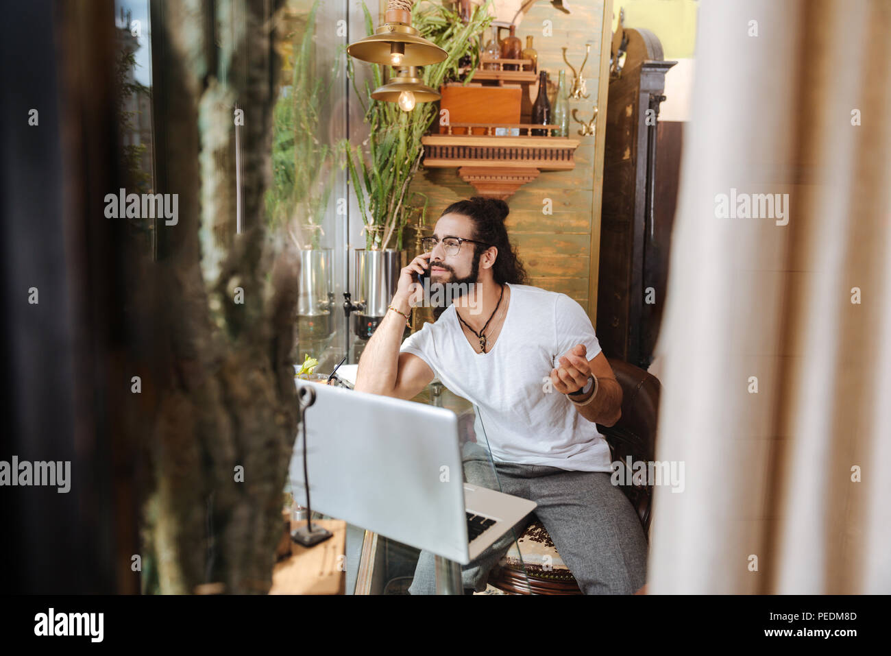 Nice adult man talking on the phone - Stock Image
