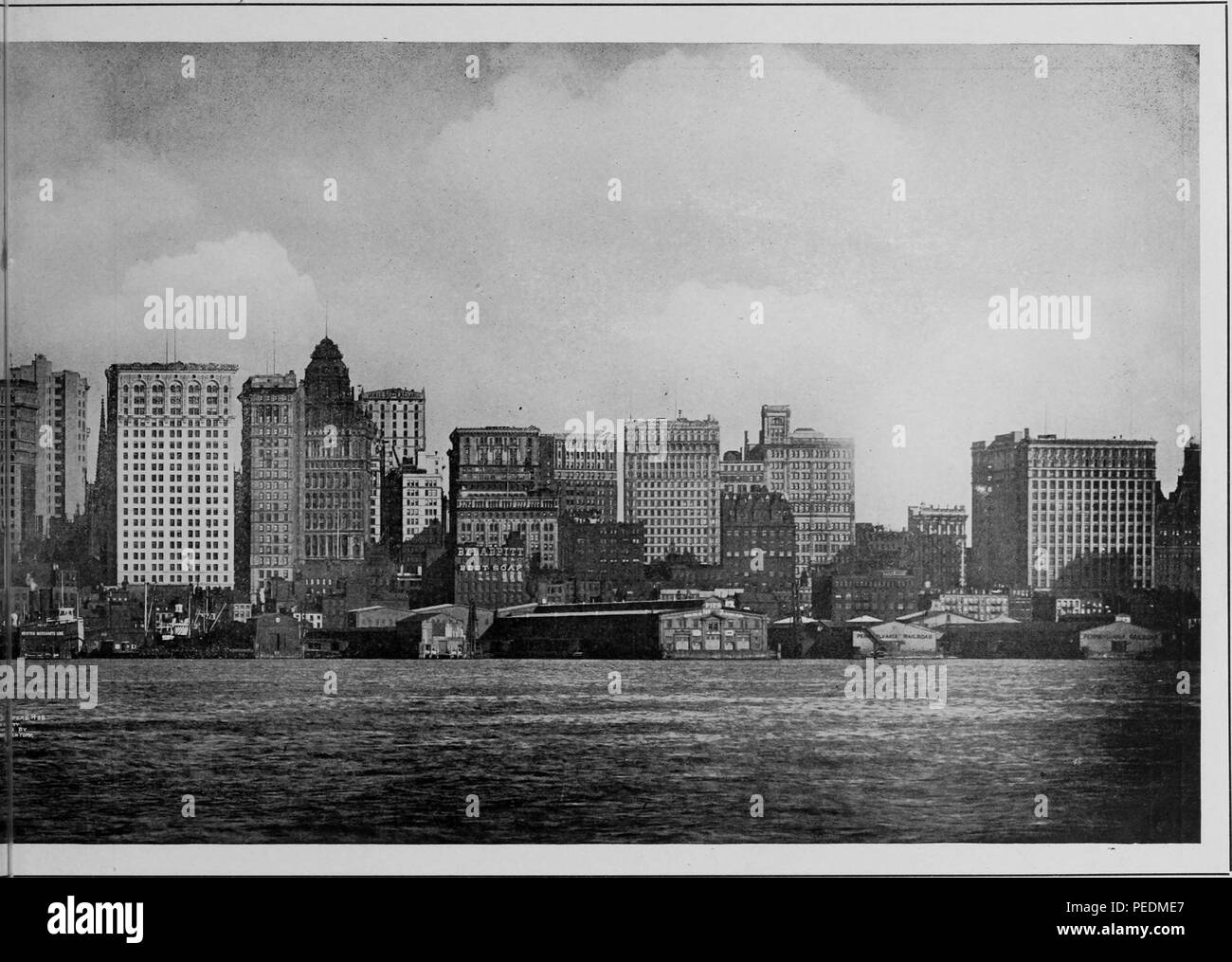 Photoengraving of the New York City skyline, New York Harbor visible in the foreground, 1912. Courtesy Internet Archive. () - Stock Image
