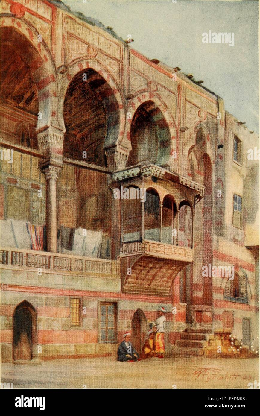 Color print depicting the external facade of the fifteenth-century funerary complex of Sultan al-Ashraf Qaytbay in Cairo, Egypt, built in the Mamluk style, with characteristically high arches and the ablaq technique which layers light and dark blocks of stone, 1912. Courtesy Internet Archive. () - Stock Image