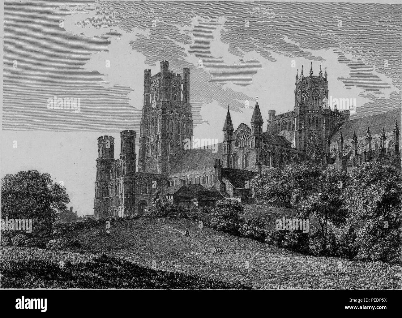 Black and white print showing an angled view of the exterior facade of 'Ely Cathedral, ' a Romanesque and Gothic style Anglican cathedral located in the city of Ely, Cambridgeshire, England, with rolling hills and trees in the foreground, engraved by William Byrne after a drawing by T Hearne, 1825. Courtesy Internet Archive. () Stock Photo