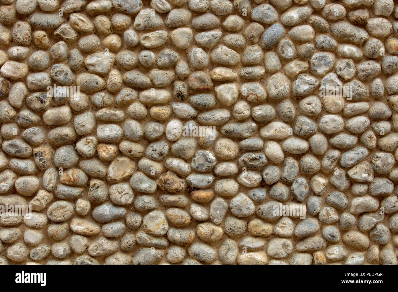 Medieval wall made of pebbles laid in mortar, old town of Norwich, UK. - Stock Image