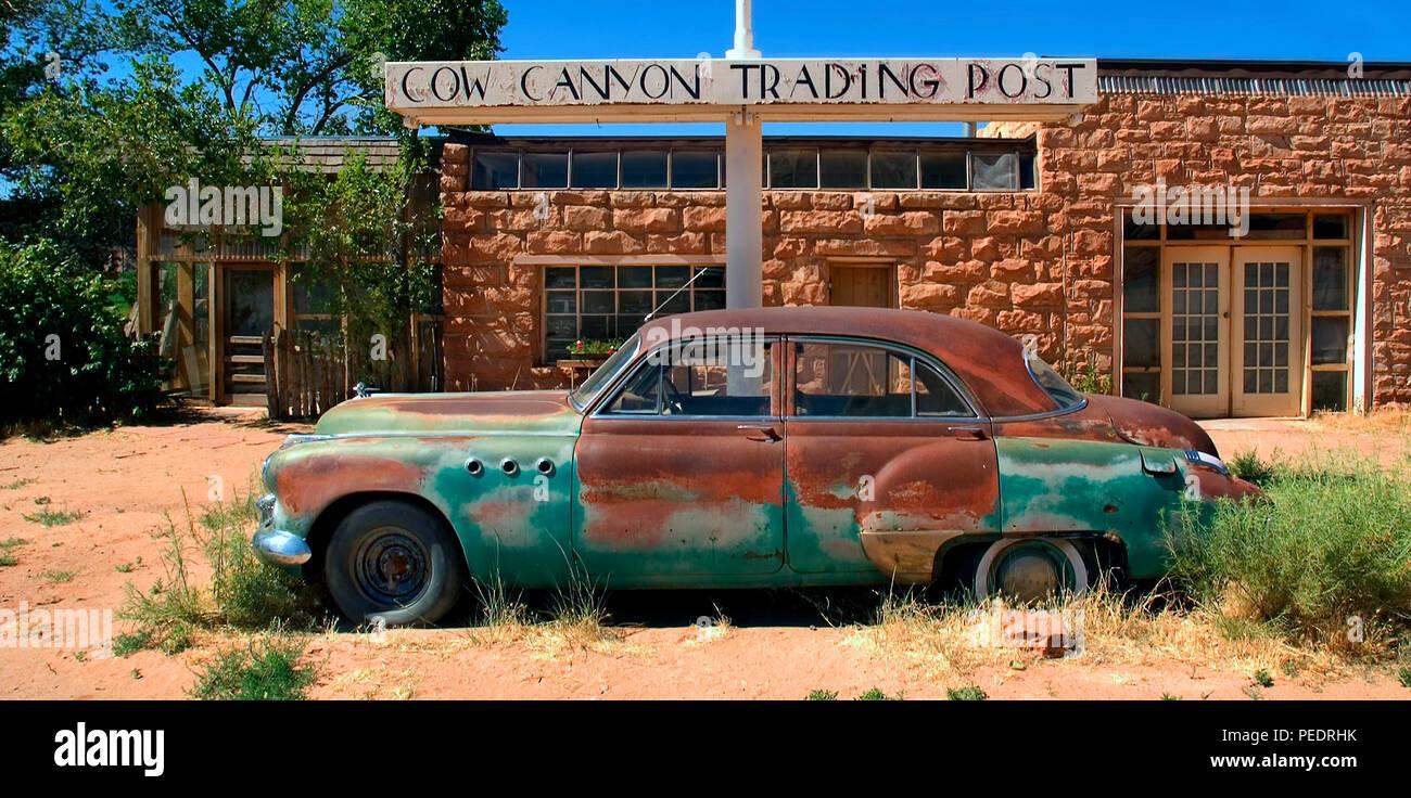 Cow Canyon Trading Post 191 262E. Utah, abandoned buick classic in front of Cow Canyon Trading Post stone building. - Stock Image