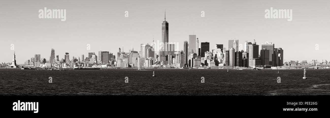 Panoramic Black & White view of Lower Manhattan skyscrapers from New York Harbor. New York City - Stock Image