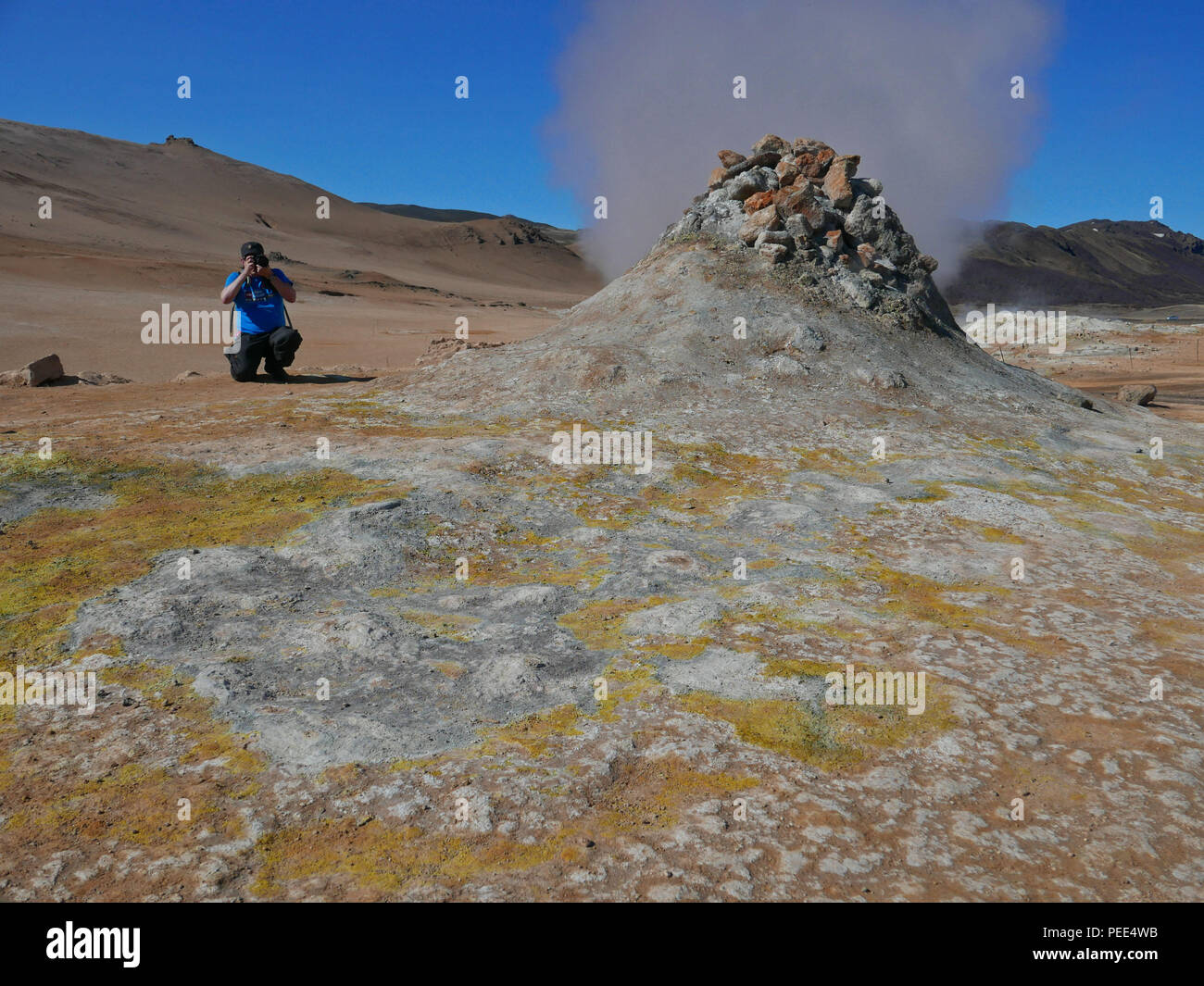 Photographing geothermal steam vents at Hverir, Myvatn, Iceland. - Stock Image