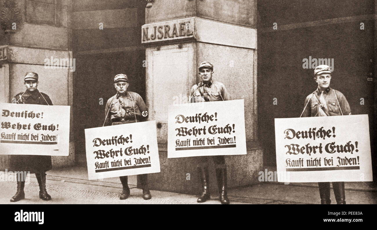 Seen here in 1933 outisde Jewish owned stores, German Nazi soldiers with placards hanging round their necks which read 'Germans! Be on your guard! Don't buy from Jews!'.  From These Tremendous Years, published 1938. - Stock Image