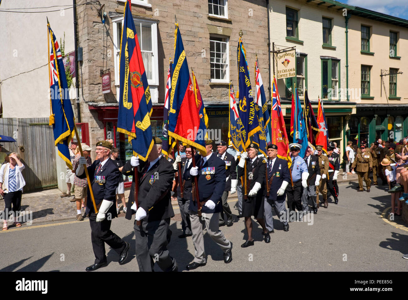 World War One commemorative event parade with military standards at Hay-on-Wye Powys Wales UK - Stock Image