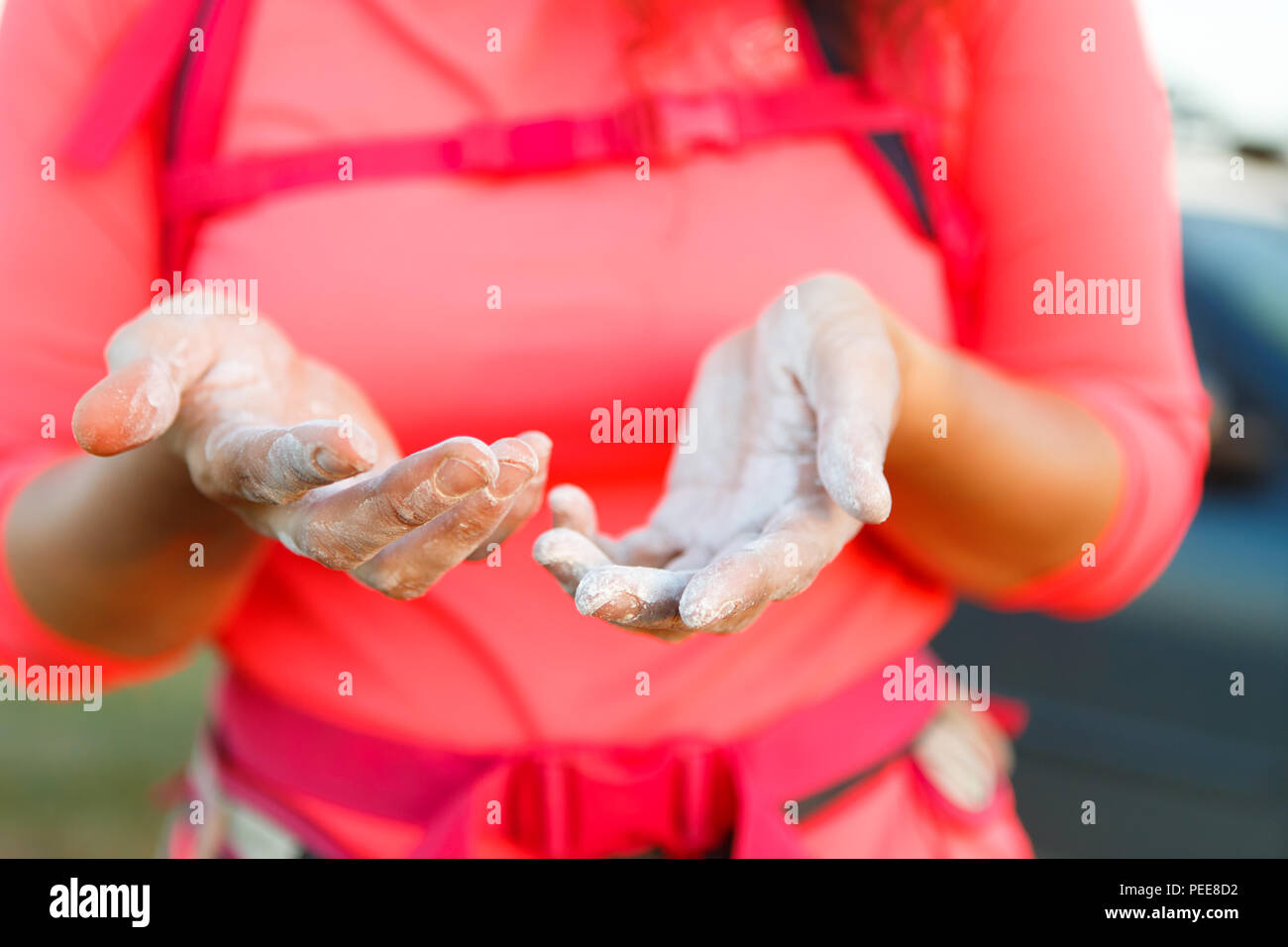 Photo of woman climber with talc on hands - Stock Image
