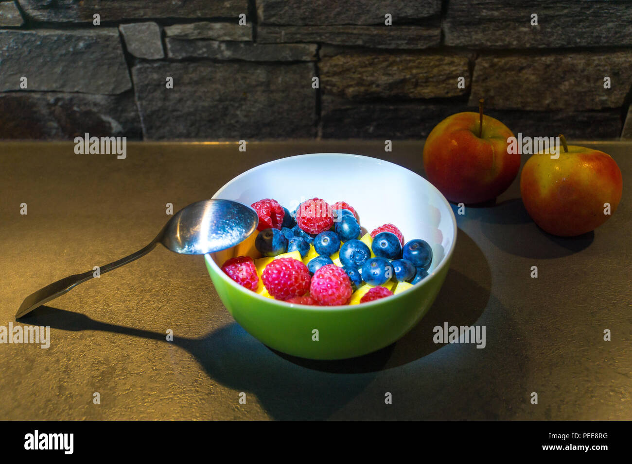 Two Apples And Colorful Healthy Fruit Mix In Dish Stock