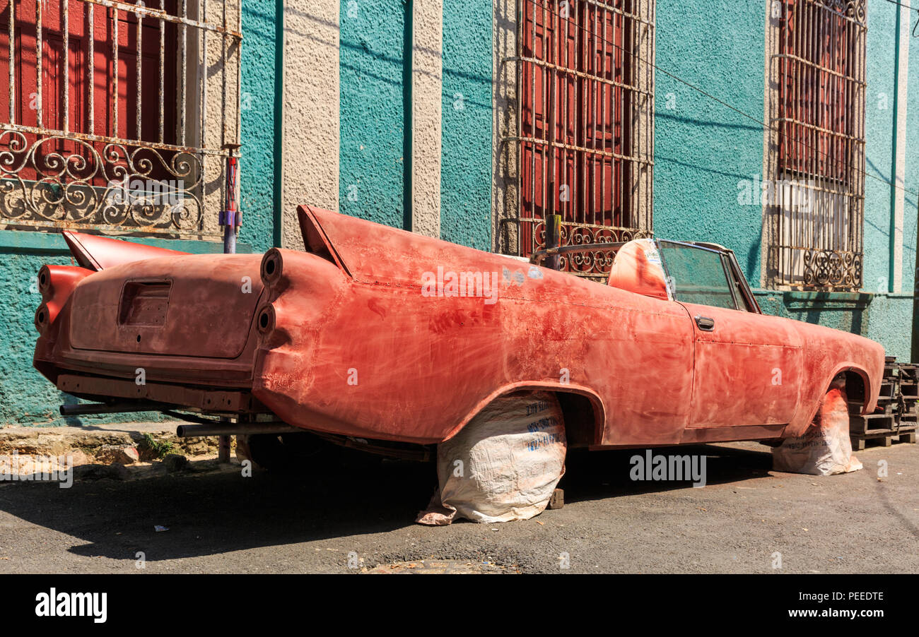 Old American classic car wreck, chassis being restored and re-painted in Havana, Cuba - Stock Image