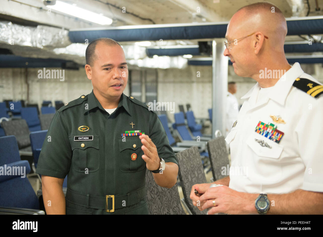 150814-N-MK341-020 SAN FERNANDO CITY, Philippines (August 14, 2015) – U.S. Navy Chaplain Lt. Michael Beasley (right) speaks to Philippine Navy Chaplain Maj. Apolonio Catada during a closing reception aboard the Military Sealift Command joint high speed vessel USNS Millinocket (JHSV 3) Aug. 14. Millinocket and embarked Task Force Forager are serving as the secondary platform for Pacific Partnership, led by an expeditionary command element from the Navy's 30th Naval Construction Regiment (30 NCR) from Port Hueneme, Calif. Now in its 10th iteration, Pacific Partnership is the largest annual multi - Stock Image